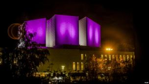 Finlandia Hall in Finland lit up pink