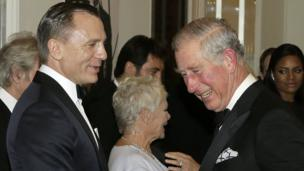 Prince Charles chats to Daniel Craig at the Skyfall premiere.