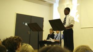 Emmanuel speaks to his fellow pupils