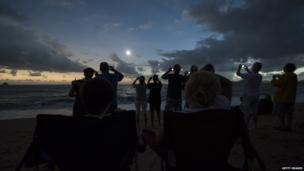 Beach with lots of people viewing the eclipse