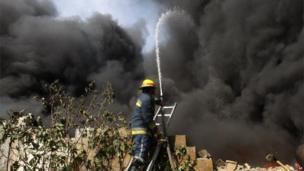 Firefighter trains jet of water on fire in Jabaliya north Gaza