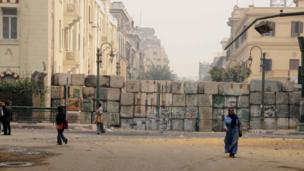 Makeshift concrete wall commemorating those who died in last year's violence on the street, Cairo.