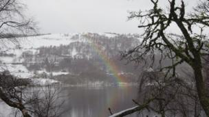 "A rainbow on Loch Tummel that Jim Sandeman and Dave MacKenzie saw as they were driving along the Foss Road on Thursday. ""It was the first time either of us saw a rainbow's end landing on a loch,"" says Jim. ""The question now . . Is the pot of gold under the loch?"""