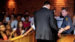 Oscar Pistorius leaves court in Pretoria, 15 February