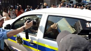 Oscar Pistorius arrives at court in Pretoria, 15 February