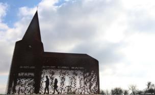 Visitors walk inside a see-through church