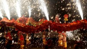 Dragon dancers perform amid fireworks in Yongchuan district in Chongqing in southwest China