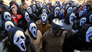 Postal workers wear masks during a protest