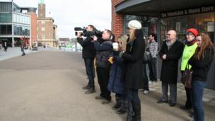 Cameramen and people gathered outside The Forum, Norwich