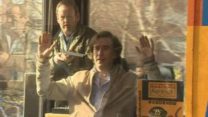 Actor Colm Meaney holds a gun to Steve Coogan's head