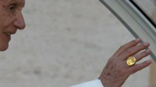 Pope Benedict XVI waves while wearing his
