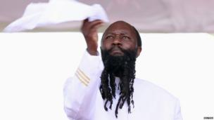 Kenyan Prophet David Owuor waves a white cloth during peace prayers at the Uhuru Park grounds in Kenya's capital Nairobi, on 24 February 2013
