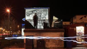 A mural in the Bogside area of Derry commemorates the beginning of the struggle in Derry for democratic rights
