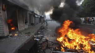 Fire lit by protesters in Bogra, Bangladesh