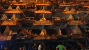 A building destroyed by a bomb blast in Karachi. Photo: 3 March 2013