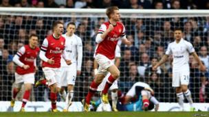 Per Mertesacker of Arsenal celebrating his goal
