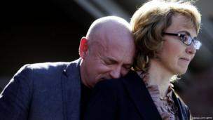 Mark Kelly leans his head on the shoulder of Gabby Giffords