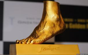 Golden statue of the left foot of Lionel Messi