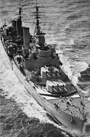 Low aerial view of HMS Belfast in 1950