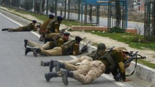 Indian paramilitary personnel take positions outside a school after an attack against Indian paramilitary personnel in Srinagar on 13 March 2013