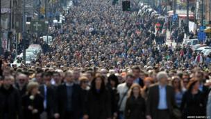 More than 15,000 people march in silence, marking the 10th anniversary of murder of Prime Minister Zoran Djindjic