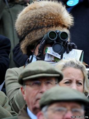 A racegoer during Champion Day of the Cheltenham Festival