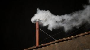 White smoke is seen from the roof of the Sistine Chapel