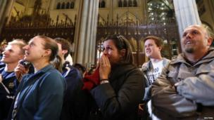 People react to the announcement of newly elected Pope Francis, Cardinal Jorge Mario Bergoglio of Argentina, at St Patrick's Cathedral in New York