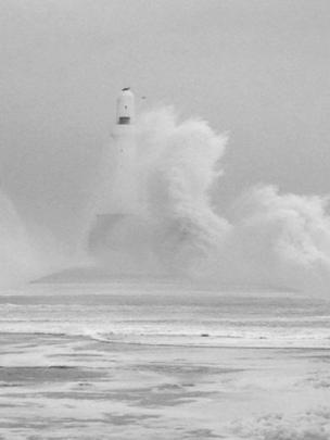 Waves crashing over Aberdeen lighthouse