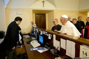 Newly elected Pope Francis checks out of the church-run residence where he had been staying in Rome