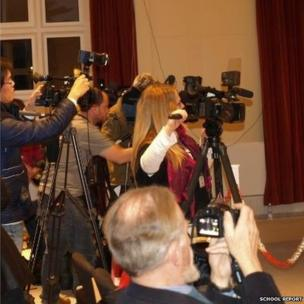 Reporters cover the press conference