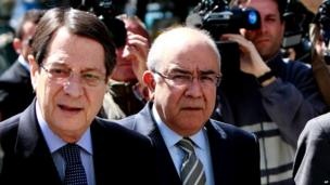 Cypriot President Nicos Anastasiades, left, and President of the Parliament Yiannakis Omirou walk toward the parliament following a meeting in capital Nicosia, Cyprus, on Monday