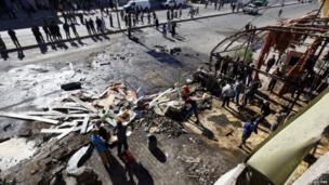 The site of a car bomb attack in the Al-Mashtal district