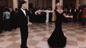 Actor John Travolta dances with Princess Diana at a White House dinner on November 9, 1985.