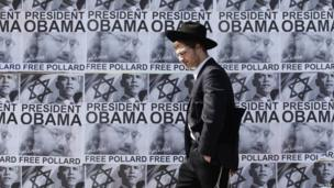 An ultra-Orthodox Jew in front of posters calling for the release of Jonathan Pollard from a US prison, Jerusalem, 20 March 2013