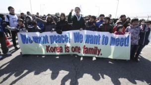 Children shout slogans during a rally to promote peace on the Korean peninsula at the Unification Bridge near the border village of Panmunjom in Paju, South Korea