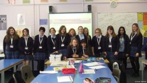 Mayfield Grammar School students stand in the classroom for a photograph