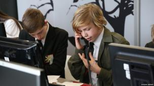 Daniel from Cowley International College takes a telephone call