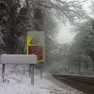 One road sign is completely covered in snow, but this is the A541 at Rhydymwyn in Flintshire early on Monday.