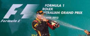 Lotus Formula 1 driver Kimi Raikkonen of Finland is sprayed with champagne