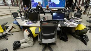 Los Angeles County officials take cover under their desk