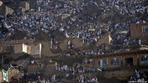 Residents of Kabul watch festivities at the Sakhi shrine