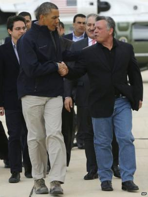 US President Barack Obama (left) shakes hands with King Abdullah of Jordan before leaving Amman airport for home, 23 March