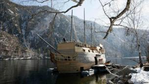 Amateur shipbuilder Alexander Marchenko works on constructing a traditional 17th century-style wooden sailing ship moored to a bank of the Yenisei River