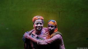 Two Hindu devotees pose for a picture during Holi celebrations in Vrindavan