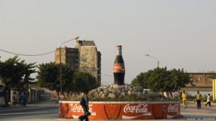 A Coca-Cola bottle dominates a roundabout in Maputo city, Mozambique
