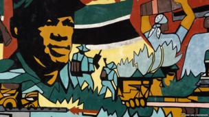 This is part of a 95m-long mural along near Maputo's main airport.