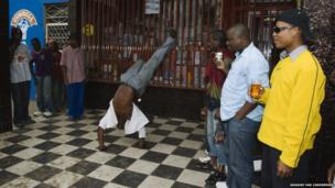 Street dancing in Xipamanine Market, Maputo.
