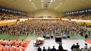 Some 2,000 children play the violin during the opening concert of the 16th Suzuki Method World Convention in Matsumoto, Japan