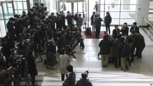 An unidentified South Korean man is surrounded by the media after returning from the North Korean city of Kaesong, April 3, 2013